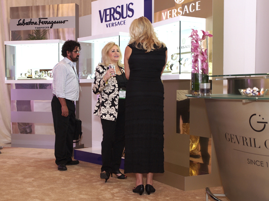 Couture Attendees Admire Versus Display
