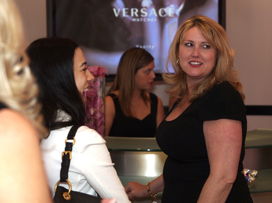 Kari Allen Holding Court at the Versace Couture 2013 Exhibit