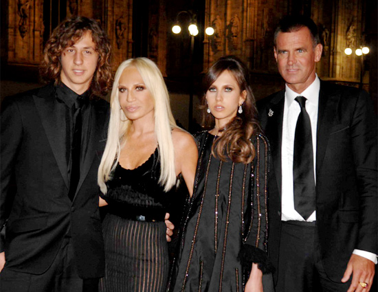 Family photo of the designer famous for Versace & Versus Versace.