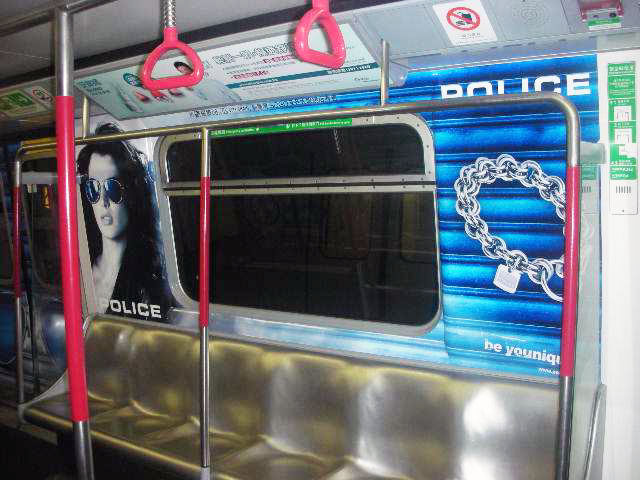 POLICE Advertising on the Hong Kong MTR Mass Transit Railway - Saloon Window Girl Jewelry Ad