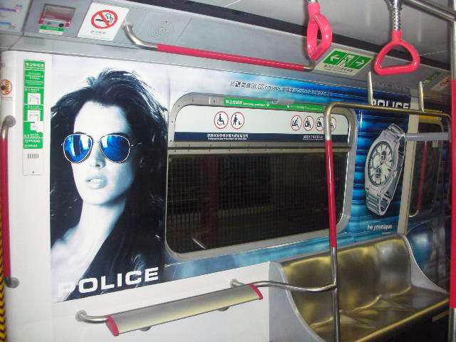 POLICE Advertising on the Hong Kong MTR Mass Transit Railway - Saloon Window Girl Watch Ad