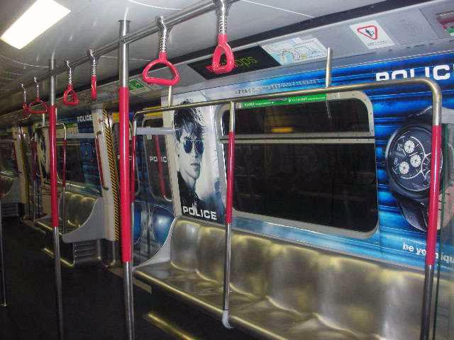 POLICE Advertising on the Hong Kong MTR Mass Transit Railway - Saloon Window Men Watch Ad