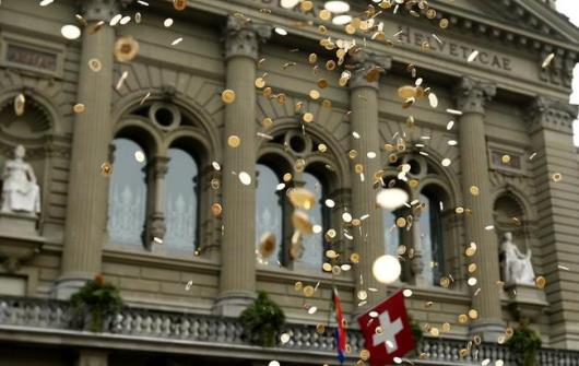 Five Cent Coins Airborne in Front of the Federal Palace, Bern Switzerland During an Event for Pay Equality