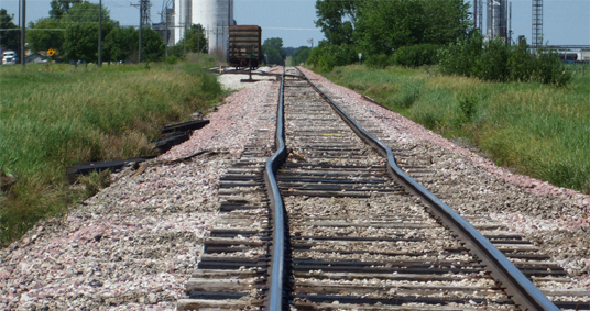 Railroad Track With Sun Kinks