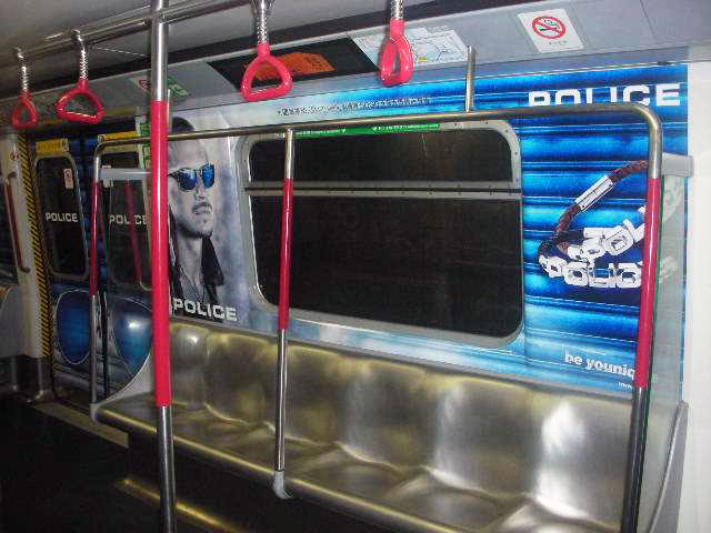 POLICE Advertising on the Hong Kong MTR Mass Transit Railway - Saloon Window Bold Jewelry Ad